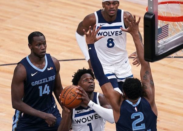 Wolves guard Anthony Edwards, the No. 1 overall pick in the draft, looked for a shot as the Grizzlies' Xavier Tillman guarded him.