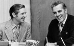 Dan Devine, left, and Ara Parseghian went over transitional matters in Parseghian's office at Notre Dame on Dec. 17, 1974. Devine left the Packers t