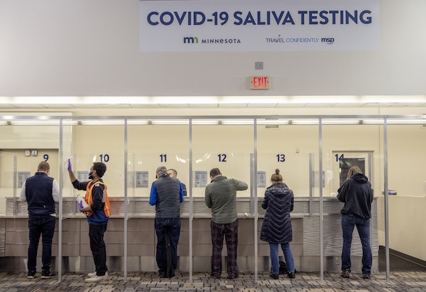 People took to the new saliva COVID-19 testing site at the Minneapolis-St. Paul International Airport, Thursday, November 12, 2020. The airport partne
