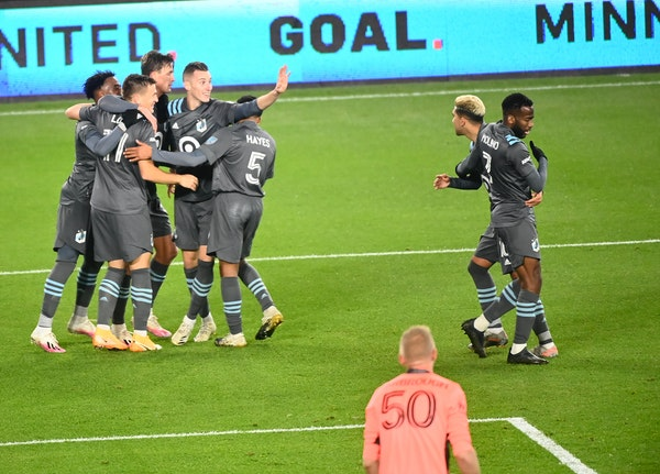 Teammates celebrated a goal by Minnesota United midfielder Robin Lod (17), second from left, late in the first half during a game this season.