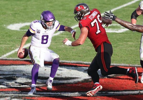 Tampa Bay Buccaneers defensive end Pat O'Connor (79) sacks Vikings quarterback Kirk Cousins (8) during the second half in Tampa, Fla. (AP Photo/Mark