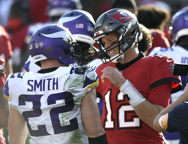Tom Brady talked to Vikings safety Harrison Smith after the game, during which he hit some long throws against the Vikings secondary.