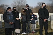 Tony Quinn put his arms around his children, Ryder, 9, and Ruby, 12, at the funeral for their great-grandfather Thursday, Dec. 10 at Fort Snelling Nat