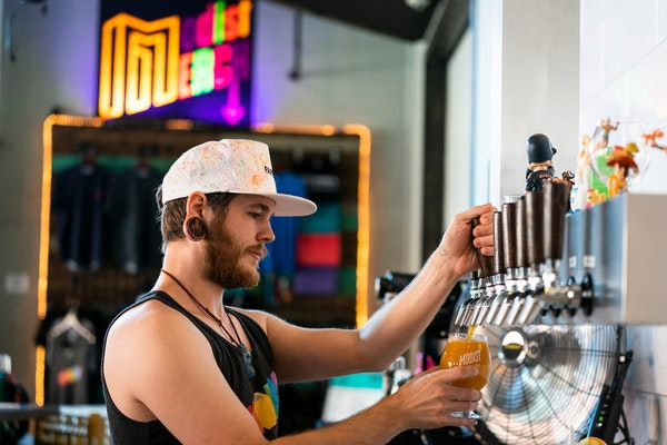 Bartender Cory Richter pours a beer atModistBrewing in 2019.
