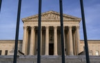 The Supreme Court in Washington, D.C., in November. The court on Friday rejected a Texas-based lawsuit to overturn the election results in four states