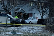 Crime scene investigators took photos on Monday, Dec. 14, of the scene where someone was fatally shot in the 500 block of Jessamine Ave. W. What appea