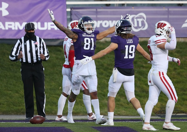Northwestern wide receiver Ramaud Chiaokhiao-Bowman (81) celebrated after a touchdown reception in the win against Wisconsin.