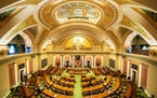 With most legislators working remotely, members present on the House floor stood for the Pledge of Allegiance at the start of the fifth special sessio