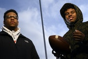 Jordan Titus, left, and Savion Robinson stood for a portrait on Dec. 12 at O'Shaughnessy Stadium on the University of St. Thomas in St. Paul.