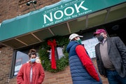 Gov. Tim Walz talked with Nook co-owner Mike Runyon in St. Paul before announcing his coronavirus relief proposals on Nov. 24. Under a deal reached Mo