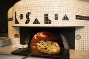 A funghi pizza emerged from the wood fired oven at Rosalia.   ]  JEFF WHEELER • jeff.wheeler@startribune.com Chef Daniel Dell Prado has opened a piz