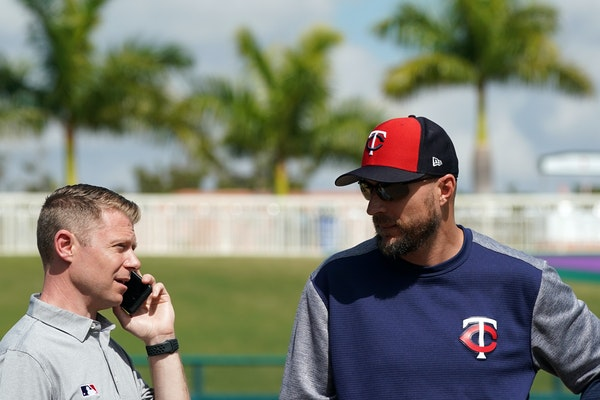 Dustin Morse, left, waited for Twins manager Rocco Baldelli to meet with reporters during spring training in 2019.