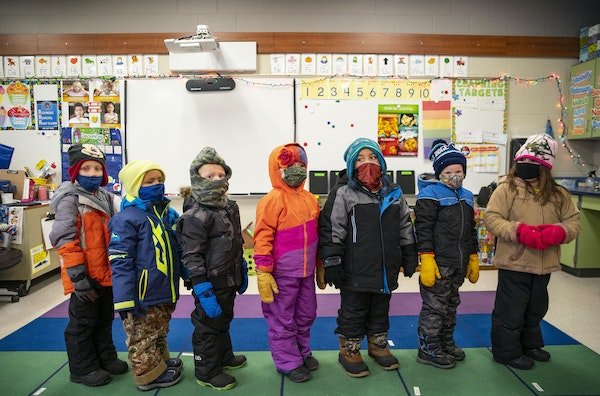 Kindergartners lined up in their winter clothes before going outside to play during recess on Thursday December 3, 2020.  ALEX KORMANN • alex.korman