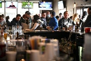 Standing-room only at the bar at Alibi Drinkery in Lakeville, which reopened Wednesday morning in defiance of Gov. Walz's orders closing bars and re