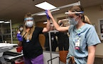 Thera Witte, RN, right, received the COVID-19 vaccine on Dec. 15, 2020 at the Minneapolis VA hospital.