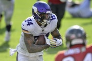 Vikings tight end Irv Smith Jr. scored on a 14-yard touchdown pass from quarterback Kirk Cousins during the second half against the Buccaneers on Sund