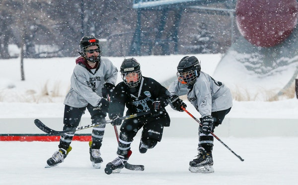 Players from the Minneapolis youth program got in their skating time on the pleasure rink near Parade Stadium during Hockey Day Minnesota. Practice ti