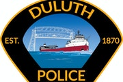 Duluth cop 'off duty indefinitely' after shooting through door