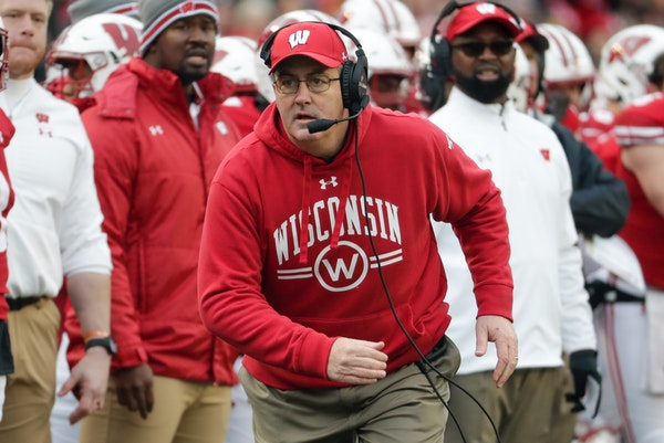 Wisconsin head coach Paul Chryst reacts during the first half of an NCAA college football game against Iowa.