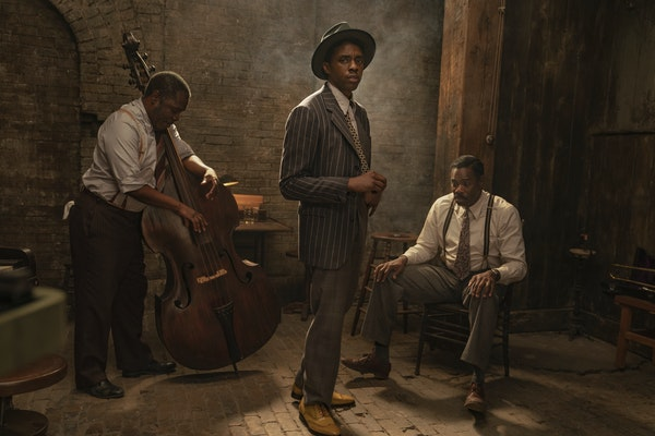 """This image released by Netflix shows Michael Potts, from left, Chadwick Boseman and Colman Domingo in """"Ma Rainey's Black Bottom.""""  (David Lee/Ne"""