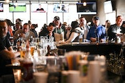 Standing room only at the bar at Alibi Drinkery in Lakeville, which reopened Wednesday morning in defiance of Gov. Tim Walz's orders closing bars an