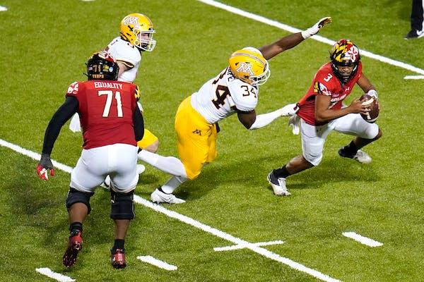 Gophers defensive lineman Boye Mafe sacks Maryland quarterback Taulia Tagovailoa during the second half on Oct. 30.