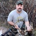 Craig Ihrke with a buck he arrowed this fall.