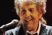 FILE - In this Jan. 12, 2012, file photo, Bob Dylan performs in Los Angeles. Universal Music Publishing Group is buying legendary singer Bob Dylan's