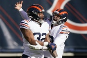 Running back David Montgomery, left, and quarterback Mitchell Trubisky have helped turn the Bears offense around.