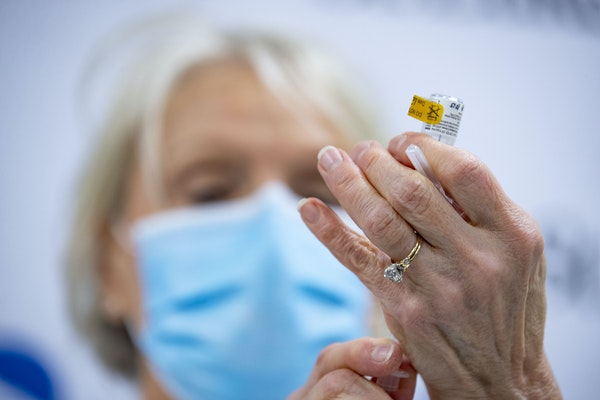 Sherry Johnson, a nurse practitioner, drew the first dose of the Pfizer COVID-19 vaccine at St. Luke's Hospital in Duluth to administer to ICU nurse