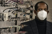 Ahmed Muhumud, co-owner of Midtown Eye Care. His move into the Midtown Global Market is part of a $2.3 million recovery plan developed by the market o