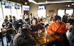 Patrons packed every table at Alibi Drinkery in Lakeville, Minn., Wednesday, Dec. 16, 2020. Monet Zarza, owner of Alibi Drinkery in Lakeville, is part