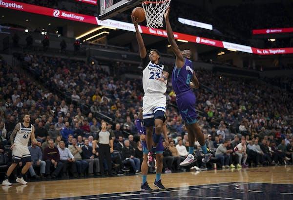 Minnesota Timberwolves guard Jarrett Culver (23) put up a second quarter shot while defended by Charlotte Hornets center Bismack Biyombo (8).   ]  JEF
