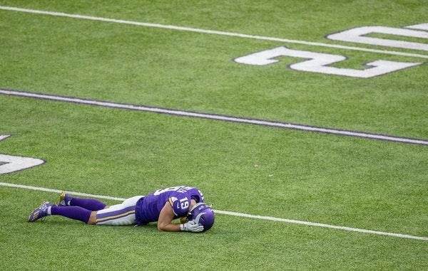 Adam Thielen laid dejected on the field after a Kirk Cousins pass was intercepted by Tennessee earlier this season.
