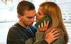 Cooper Juliar hugged his mother Lisa as she spoke on the phone with one of Cooper's teachers.     ]  Shari L. Gross • shari.gross@startribune.com
