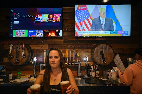 As workers served patrons at Alibi Drinkery in Lakeville on Wednesday, Dec. 16, Gov. Tim Walz's address was broadcast in the background. Restaurants