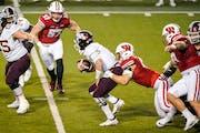 Wisconsin linebacker Leo Chenal (45) sacks Gophers quarterback Tanner Morgan during the second half
