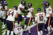 Bears running back David Montgomery (32) celebrates with his teammates after scoring a touchdown Sunday.