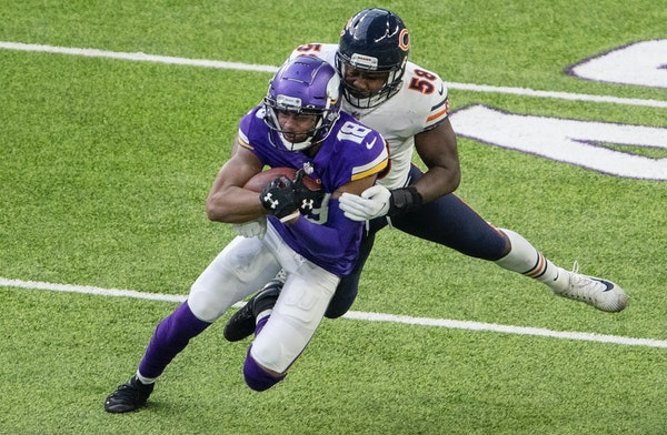 Minnesota Vikings receiver Justin Jefferson (18) was tackled by Roquan Smith (58) of the Chicago bears in the third quarter last week.