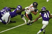 Vikings defensive tackle Jaleel Johnson got a hand on Bears running back David Montgomery as he rushed the ball in the fourth quarter.