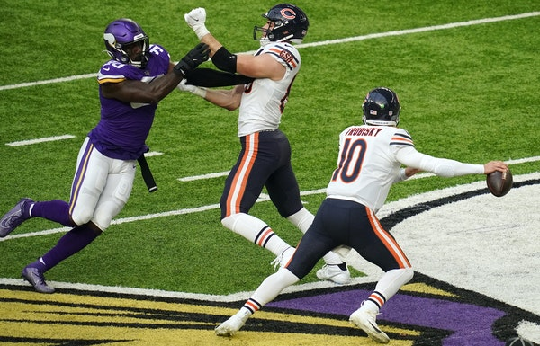 Bears quarterback Mitchell Trubisky often rolled out Sunday, this time outside of Vikings defensive end Jalyn Holmes.