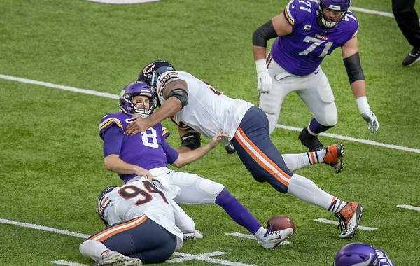 Vikings quarterback Kirk Cousins after fumbling on a sack in the second quarter against the Bears.