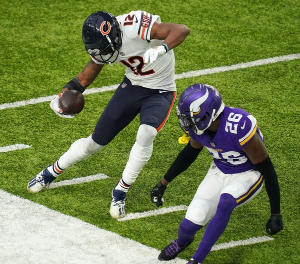 Chicago Bears wide receiver Allen Robinson (12) stopped himself from running out of bounds as Minnesota Vikings defensive back Chris Jones (26) raced