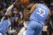 Clippers forward Kawhi Leonard (2) tried to muscle through Minnesota Timberwolves center Karl-Anthony Towns last season.