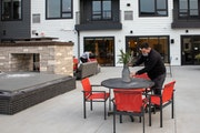 Birke apartment staff Jake Gleason and Vadell Johnson prepped the terrace, which Doran Cos. installed with a heated deck so tenants can use it in wint