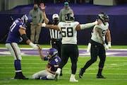 Vikings left tackle Riley Reiff helps quarterback Kirk Cousins get up after he was sacked against the Jaguars Dec. 6.