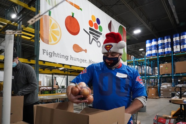 James Gottfried, a frequent volunteer, filled a box with food at the Food Group in New Hope.