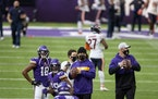 Vikings linebacker Eric Kendricks, center, and tight end Kyle Rudolph, right, did not play against the Bears on Sunday.