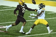 Gophers cornerback Phil Howard, above breaking up a pass vs. Iowa, is among the many seniors who plan to return in 2021 after the NCAA gave everyone a
