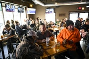 Patrons packed every table at Alibi Drinkery in Lakeville, Minn., Wednesday, Dec. 16, 2020. An attorney representing Alibi Drinkery co-owner Lisa Mone